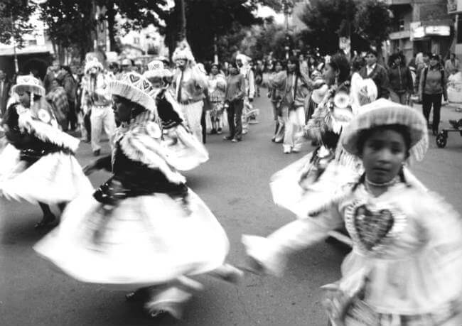 Bolivia dancers share their culture with our small group tour