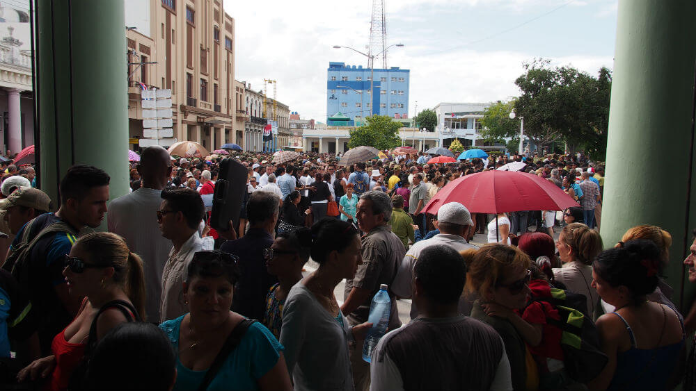 Crowds of people fill the main plaza.